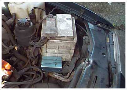 Figure 6. The data logger is located next to the car battery in perhaps the coolest area of the engine compartment. Car designers typically locate the battery in this area to prevent its electrolytes from boiling.