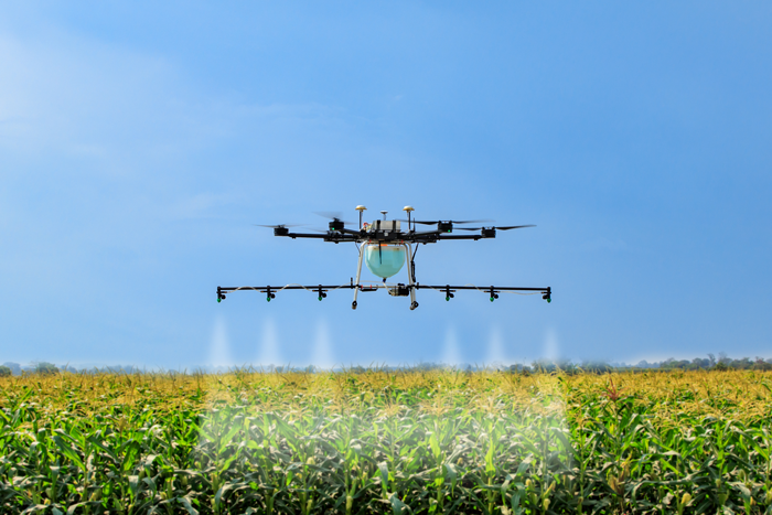 A drone being used to spray crops.