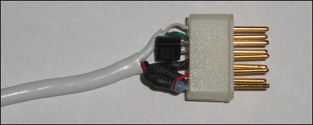 Figure 2. DB9 connector with embedded TO92 1-Wire device before injection molding.